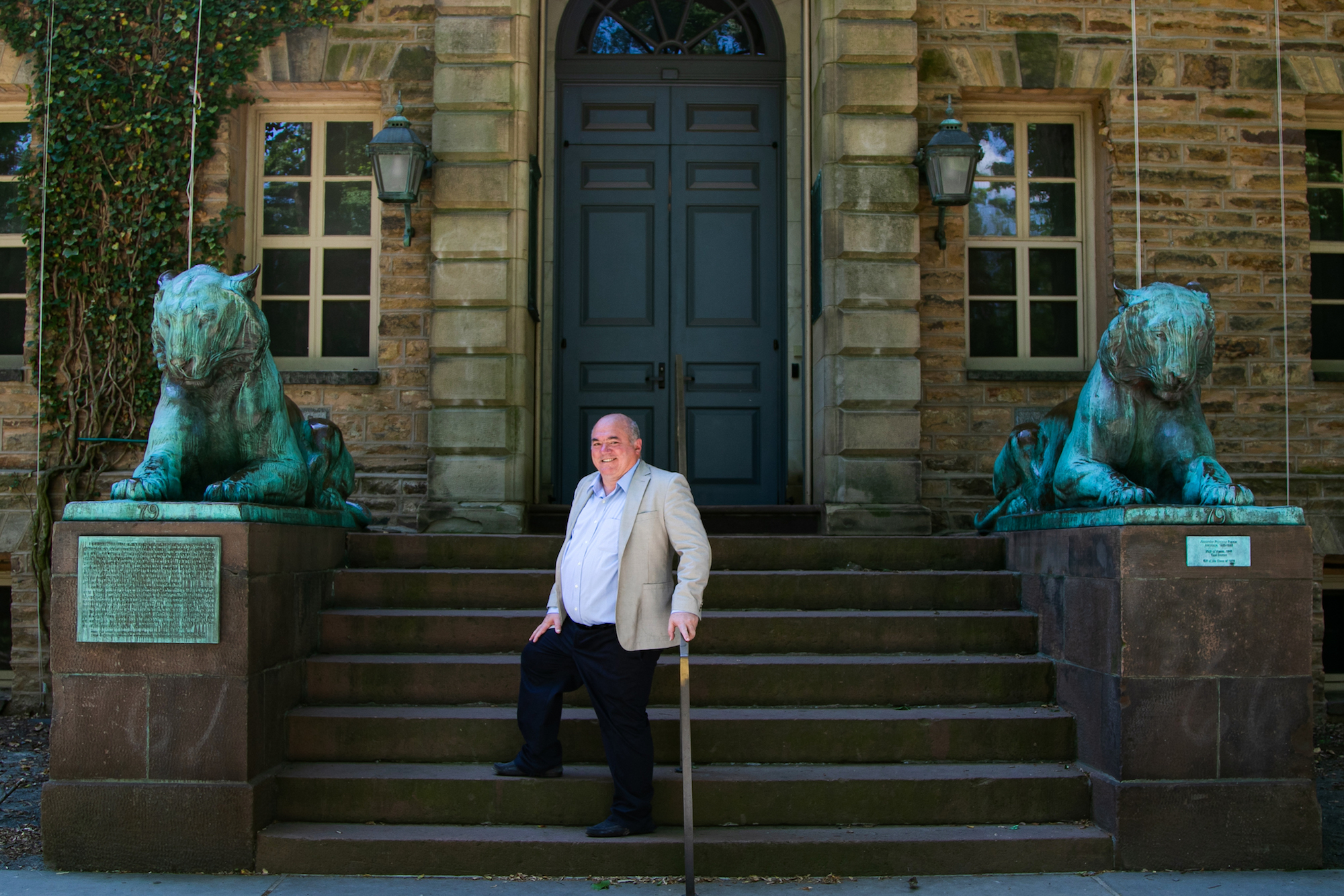The founder of Network for Teaching Entrepreneurship (NFTE) Steve Mariotti stands on stairs in Princeton University in New Jersey on June 25, 2020. (Chung I Ho/The Epoch Times)